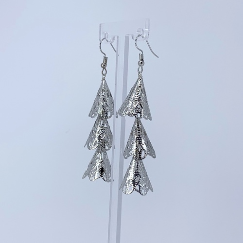 Side view of RAJNI silver tone tier-drop earrings