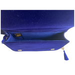 Interior view of the TASSIE royal blue velvet crossbody bag with tassels