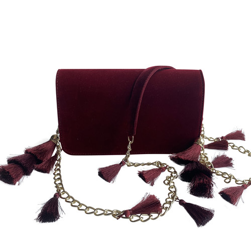 Front view of TASSIE burgundy velvet crossbody bag with tassels