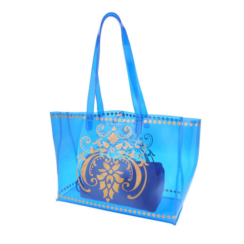 Side view of the JEWEL transparent blue PVC tote bag with removable pouch inside