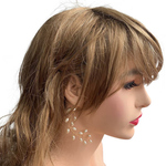 Model wearing VINI modular pearl vine ear cuffs as a feather