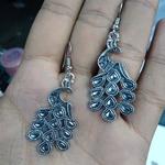 GS peacock earrings