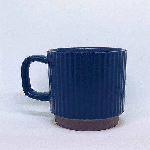 Ribbed Blue Mug with handle and a smaller circular brown base.