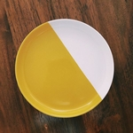 8 inch yellow and white porcelain plate.