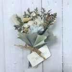 A blue bouquet of dried flowers and blue carnation.