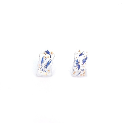 A pair of clear rectangular stud earrings with blue and gold foil inside