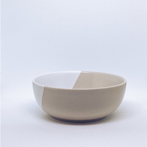 A light grey and white porcelain sauce bowl.