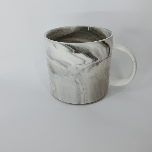 A blue grey marbled mug with handle.