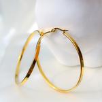A pair of medium gold hoop earrings.