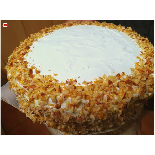 ALMOND CAKE WITH WHITE CHOCOLATE ORANGE/LEMON MERINGUE ICING (1 kg) [Only available for pickups]