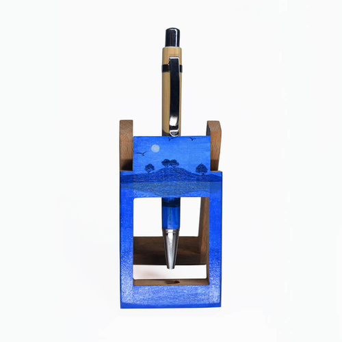 Pen stand with blue coloured landscape